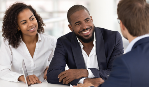 Happy African American couple consulting a REALTOR®
