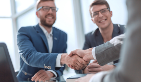 A close up of successful business people shaking hands